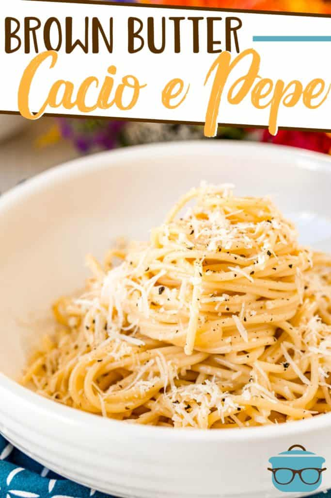 Brown Butter Cacio e Pepe recipe from The Country Cook, pictured in a white bowl topped with freshly grated Parmesan cheese and cracked black pepper