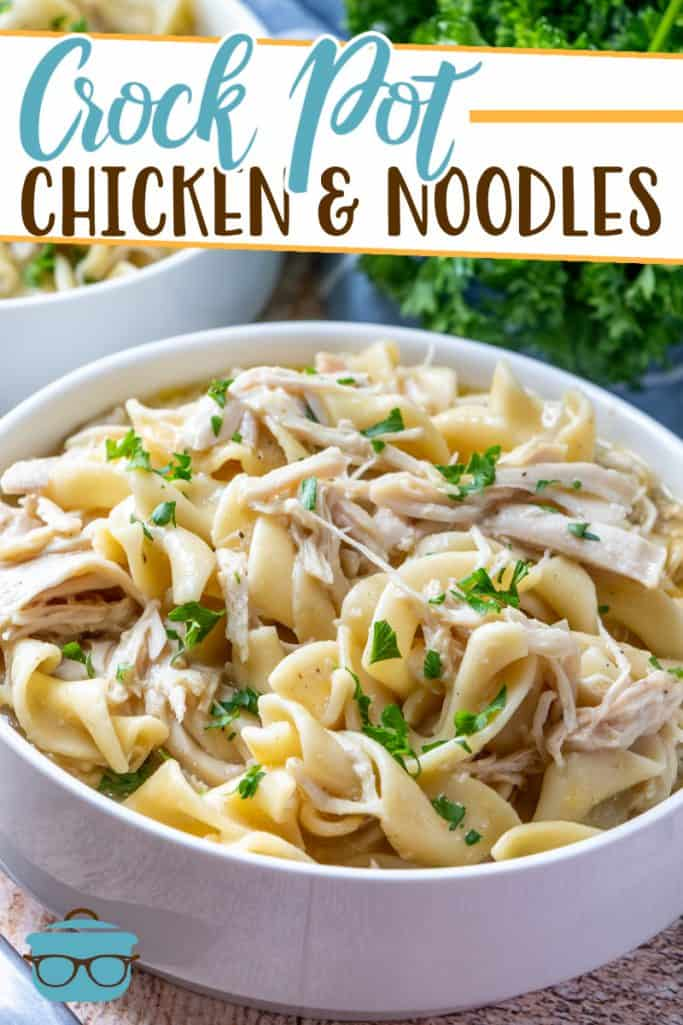 Crock Pot Chicken and Noodles recipe from The Country Cook, shown in a white bowl with parsley in the background