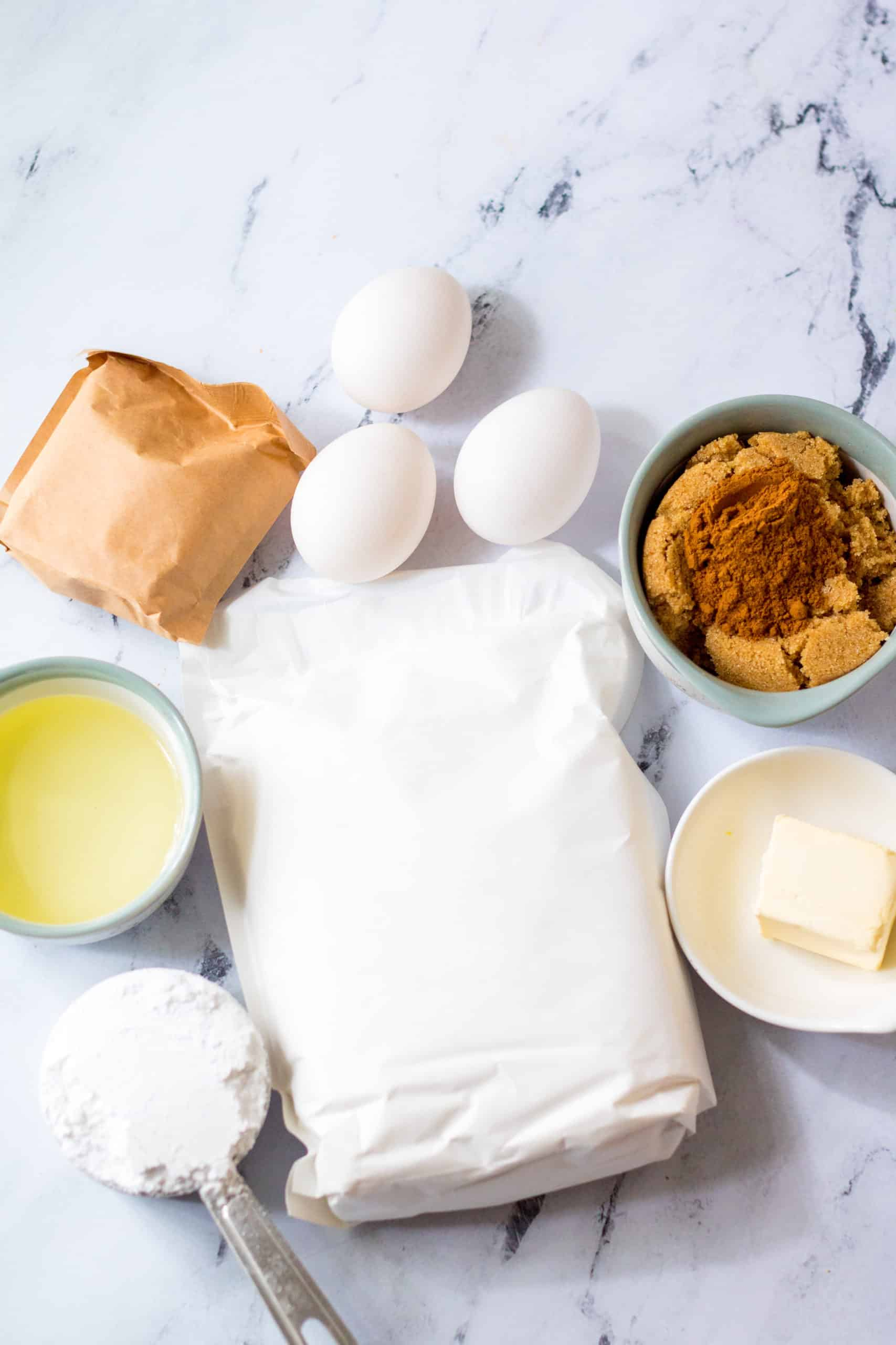 white cake mix, water, oil, eggs, instant vanilla pudding, salted butter, light brown sugar, ground cinnamon, powdered sugar, water