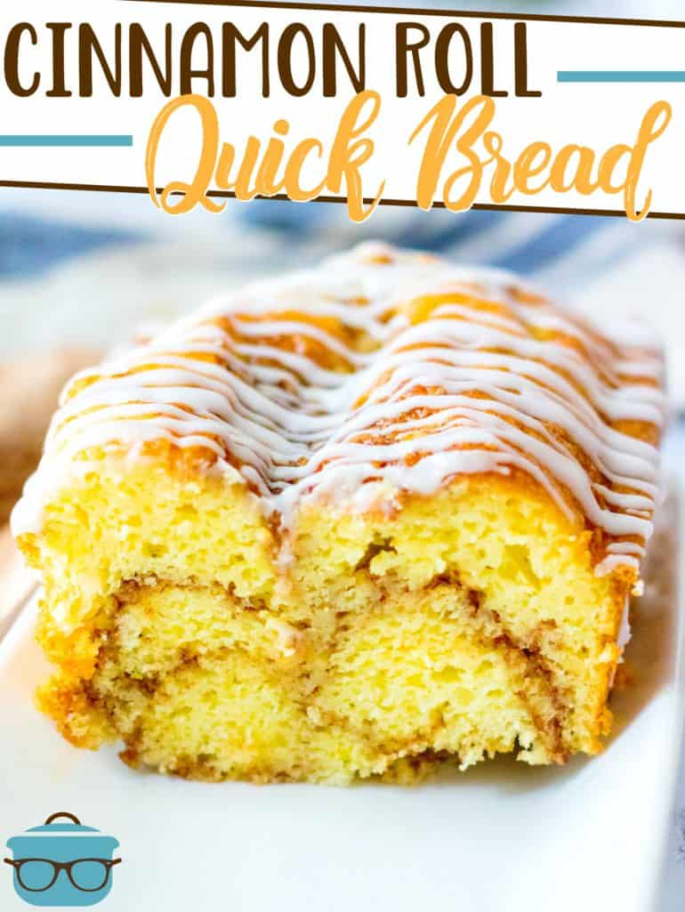 Cinnamon Roll Quick Bread recipe from The Country Cook, pictured - bread on a long white plate and sliced in half
