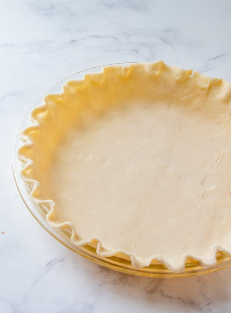 refrigerated pie crust pressed into a pie pan with fluted pie edges