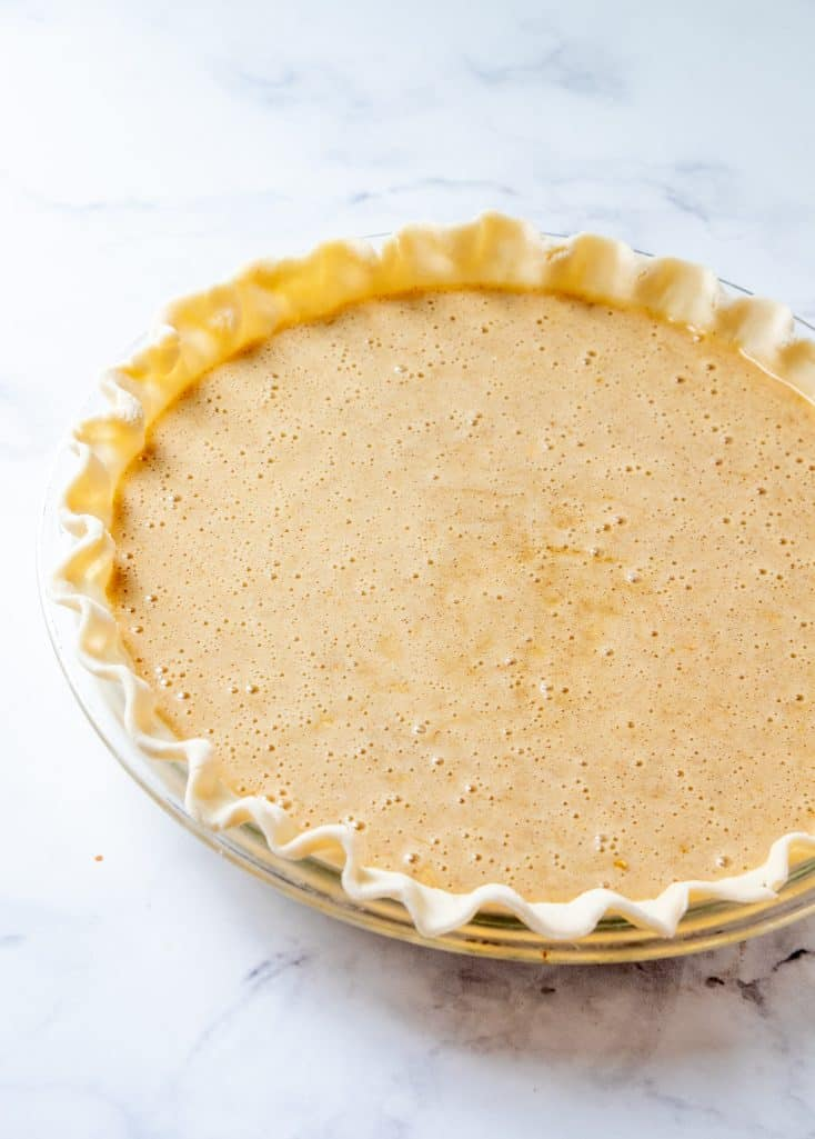 oatmeal pie batter poured into pie crust