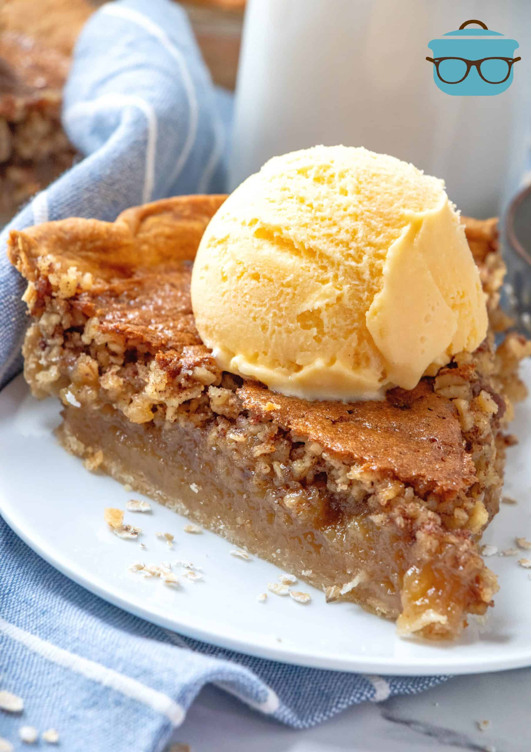 slice of Oatmeal Pie on a plate and topped with a scoop of ice cream