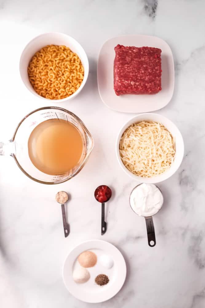 ground beef, ketchup, mustard, garlic powder, onion powder, salt &pepper, elbow macaroni, chicken broth, shredded sharp cheddar cheese, sour cream