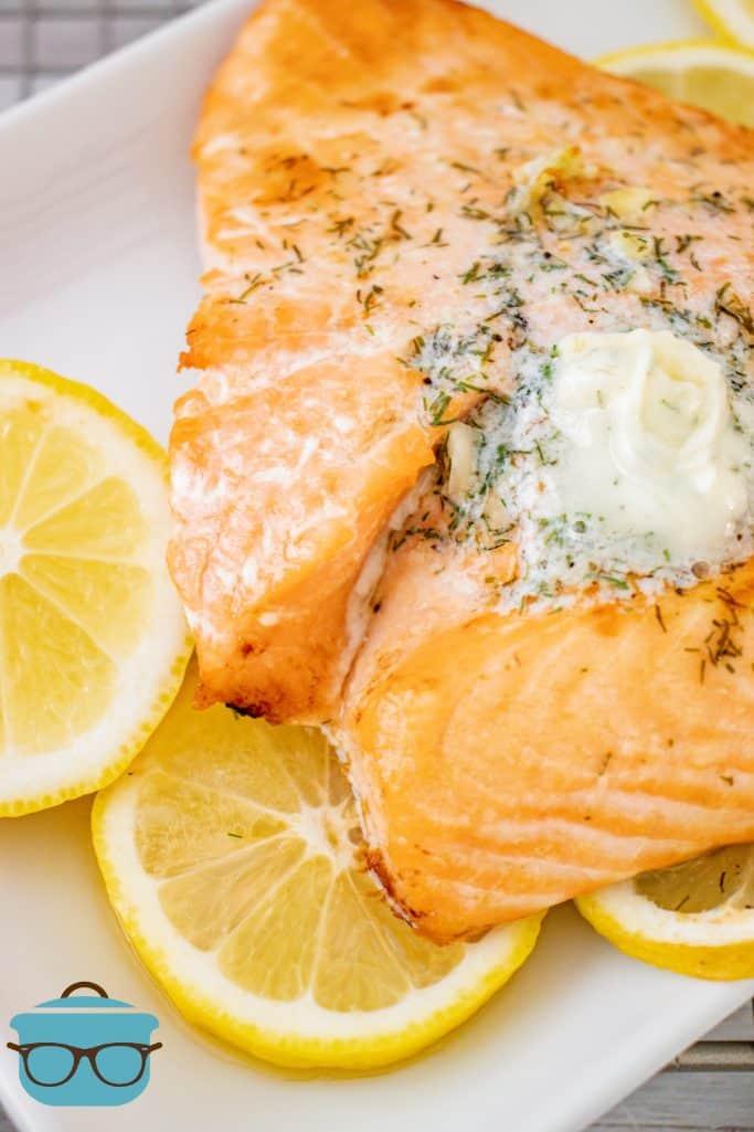 Air Fryer Salmon, shown on sliced lemon on a white plate