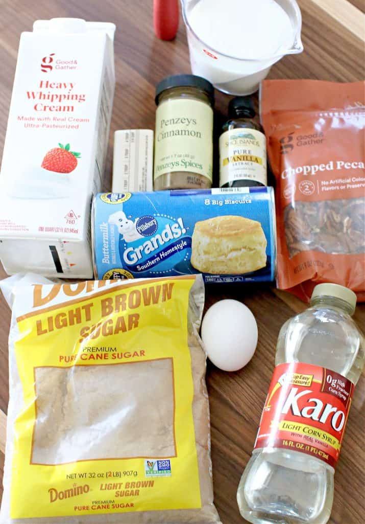 French Toast casserole ingredients: refrigerator biscuits, egg, sugar, ground cinnamon, vanilla extract, heavy cream, milk, salted butter, light brown sugar, chopped pecans, corn syrup