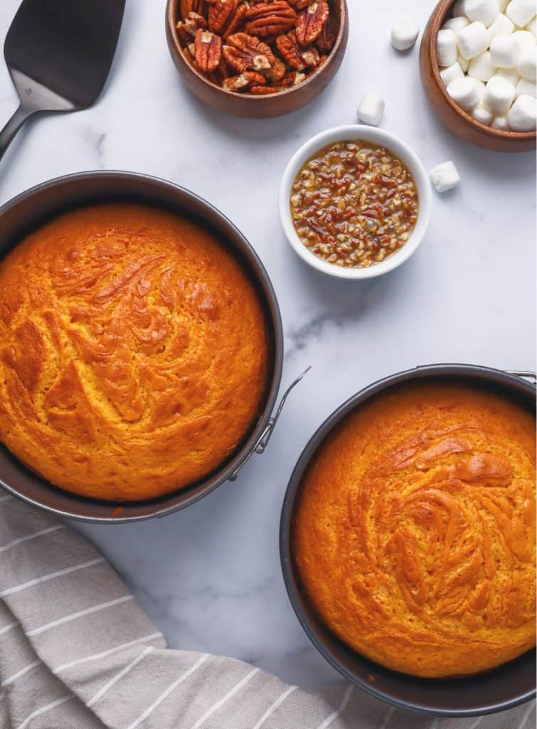 sweet potato cake in springform pans cooling on a counter