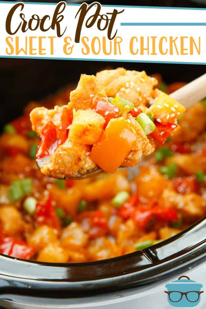 Crock Pot Sweet and Sour Chicken from The Country Cook, shown in a crock pot with a wooden spoon scooping some out