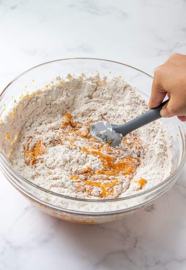 flour mixture added to pumpkin batter