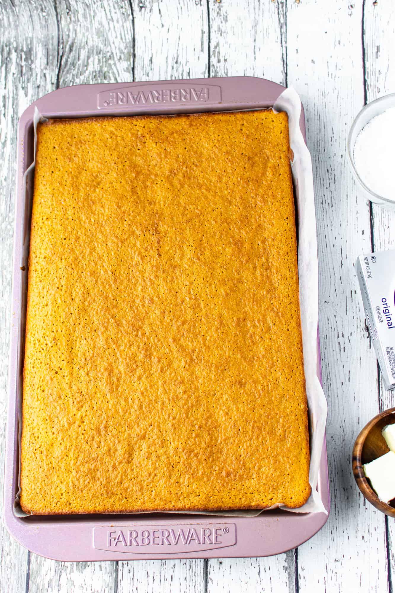 fully baked pumpkin cake shown in baking pan.