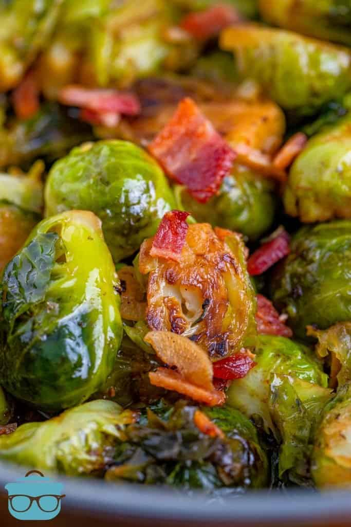 Stovetop Brussel Sprouts shown closeup, fully cooked and chopped bacon
