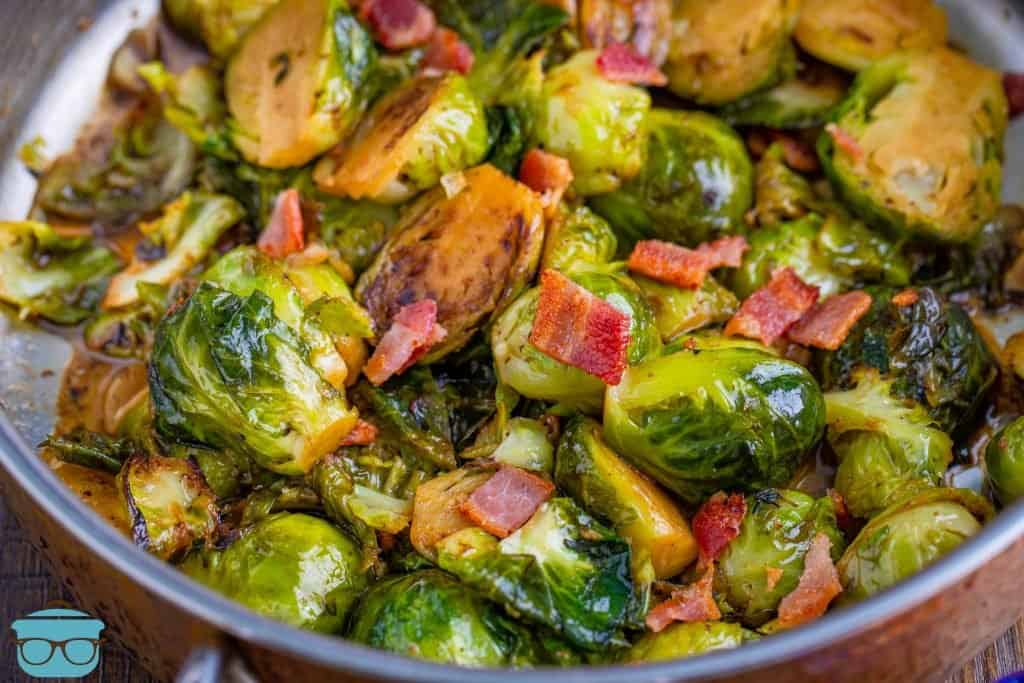 Stovetop Brussel Sprouts with Bacon shown in a silver frying pan