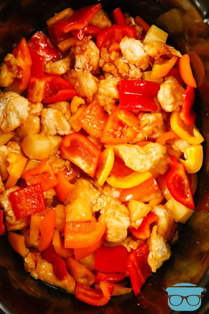 Crock Pot Sweet and Sour Chicken, before cooking, in an oval black slow cooker