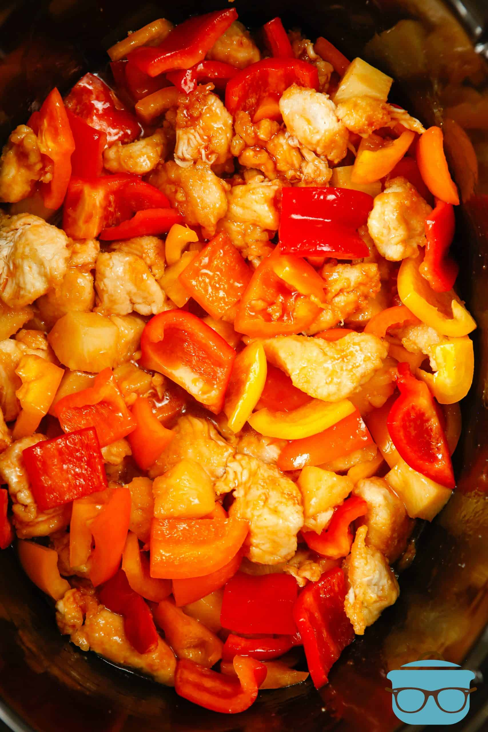 Crock Pot Sweet and Sour Chicken, before cooking, in an oval black slow cooker.