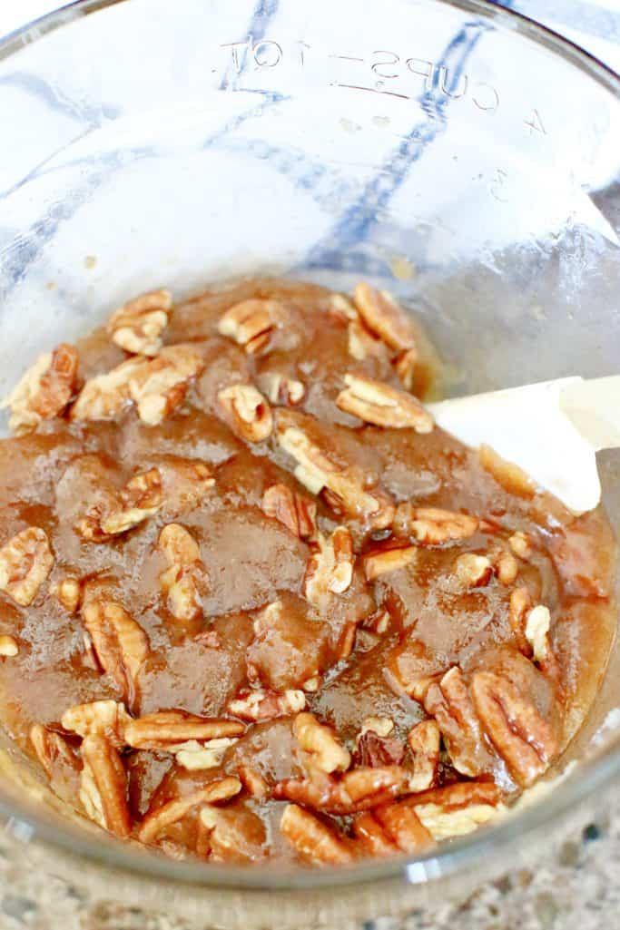 melted butter, brown sugar, cinnamon and chopped pecans mixed together in a bowl
