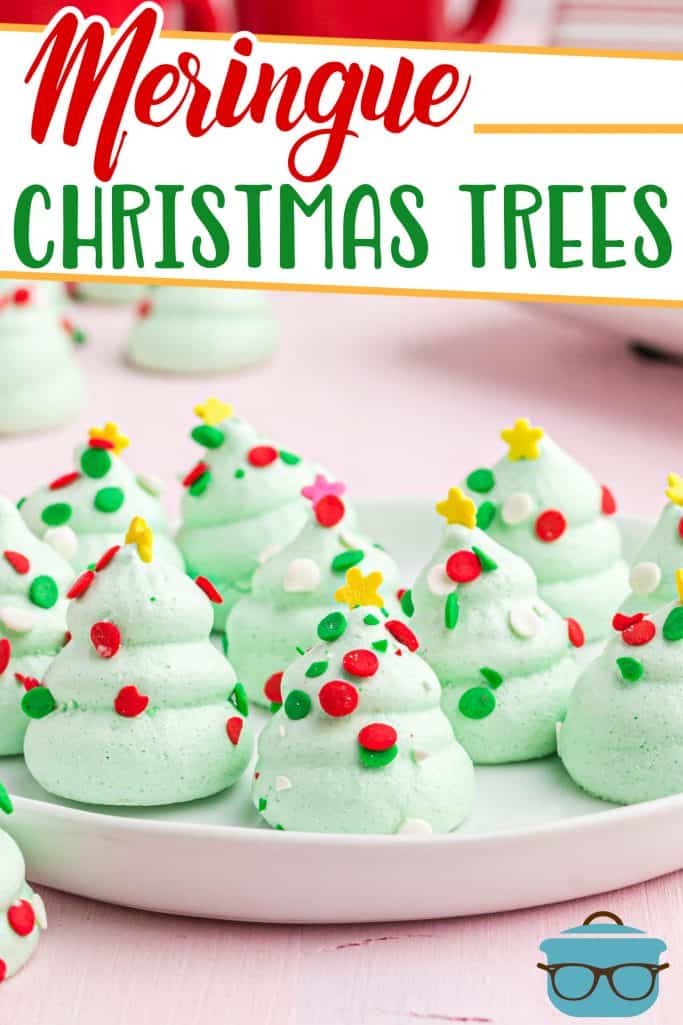 Adorable and Easy Meringue Christmas Trees recipe from The Country Cook, finished meringue cookies shown on a white circle tray