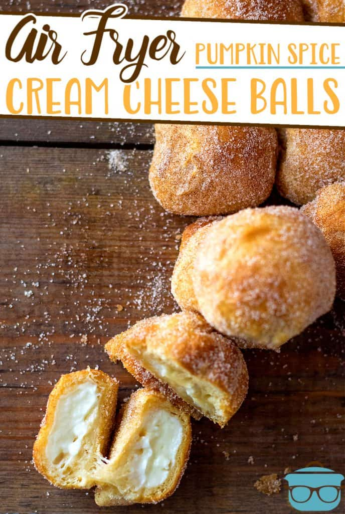 Air Fryer Pumpkin Spice Cream Cheese Bites recipe from The Country Cook, bites shown on a wooden surface with one cream cheese bite opened to show the middle