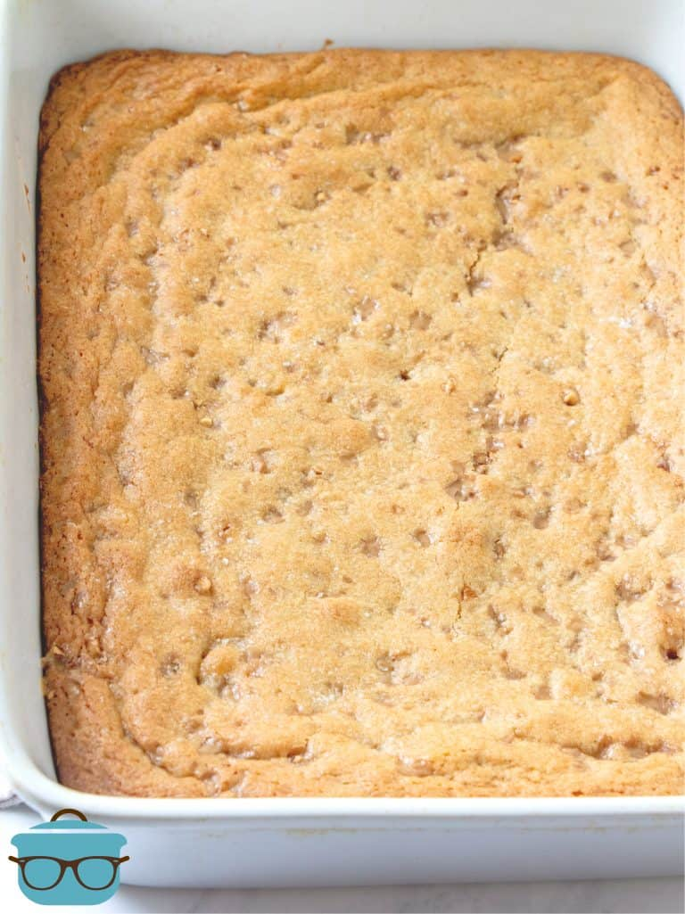Fully baked butter rum blondies in a white baking dish