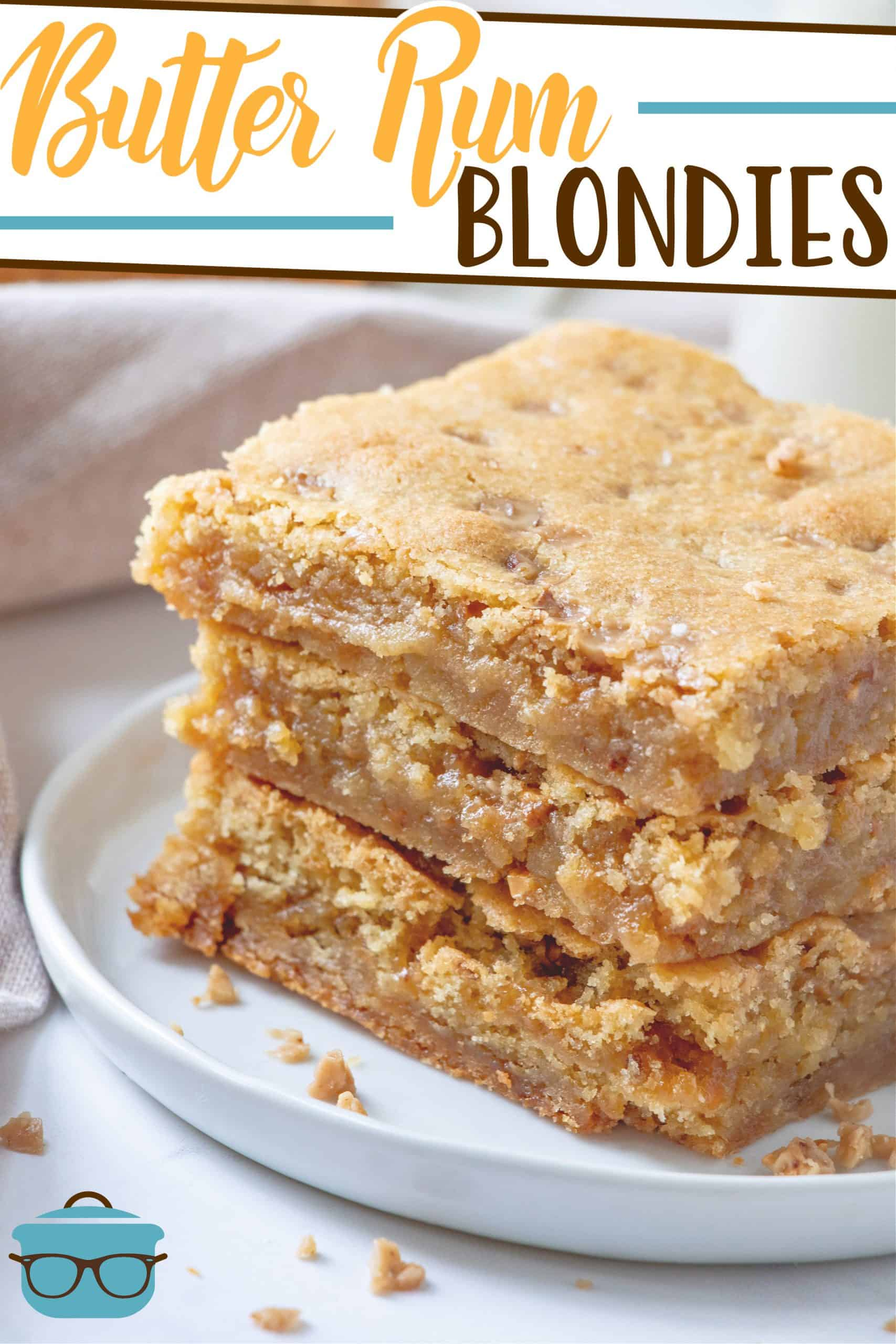 Easy Homemade Butter Rum Blondies recipe from The Country Cook, three blondies stacked on a white circle plate.