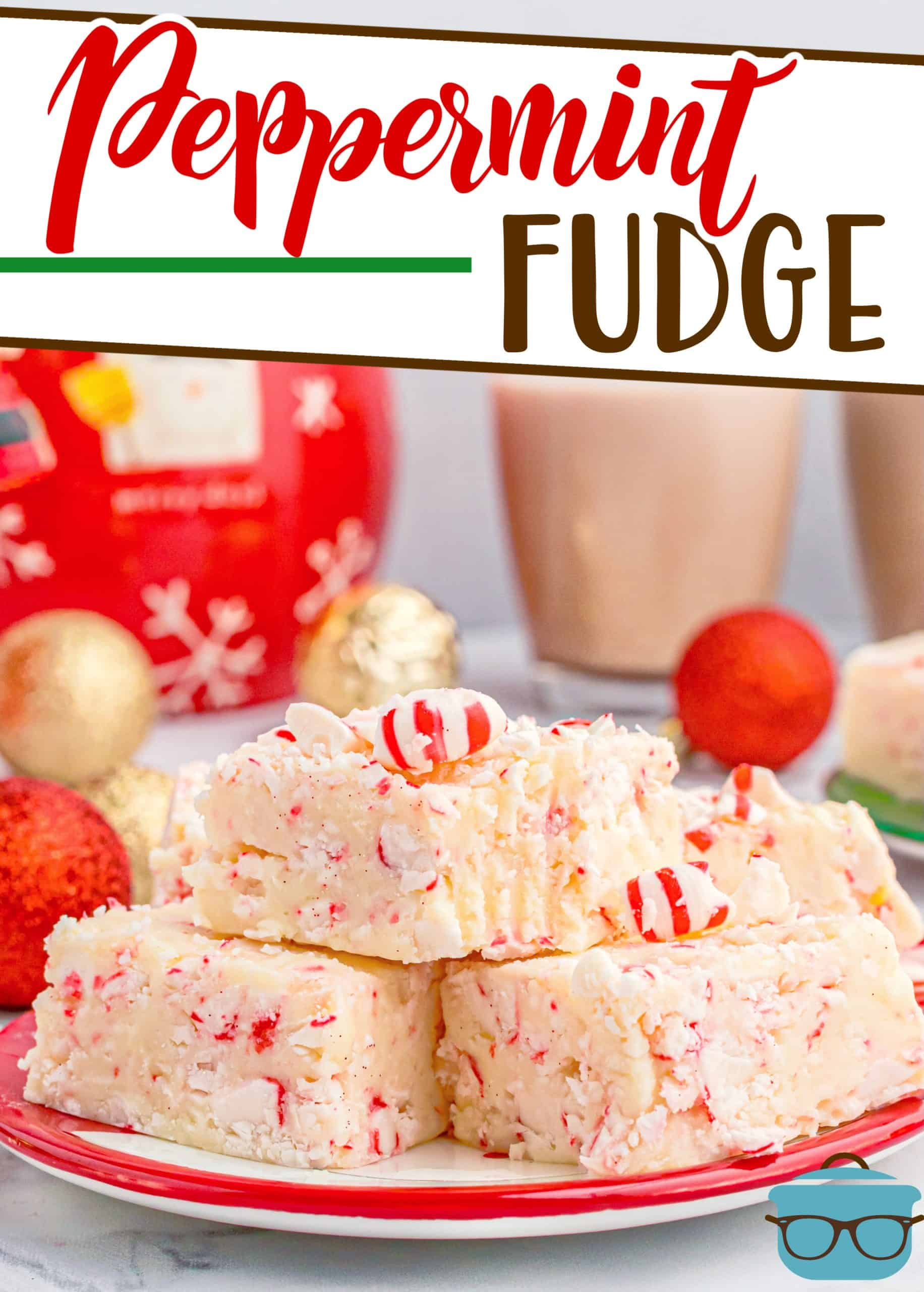Easy Candy Cane Peppermint Fudge recipe from The Country Cook, pieces of fudge shown stacked on a red and white plate with hot chocolate in the background.