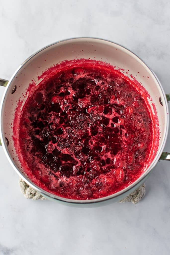 crushed cranberries in a silver sauce pan