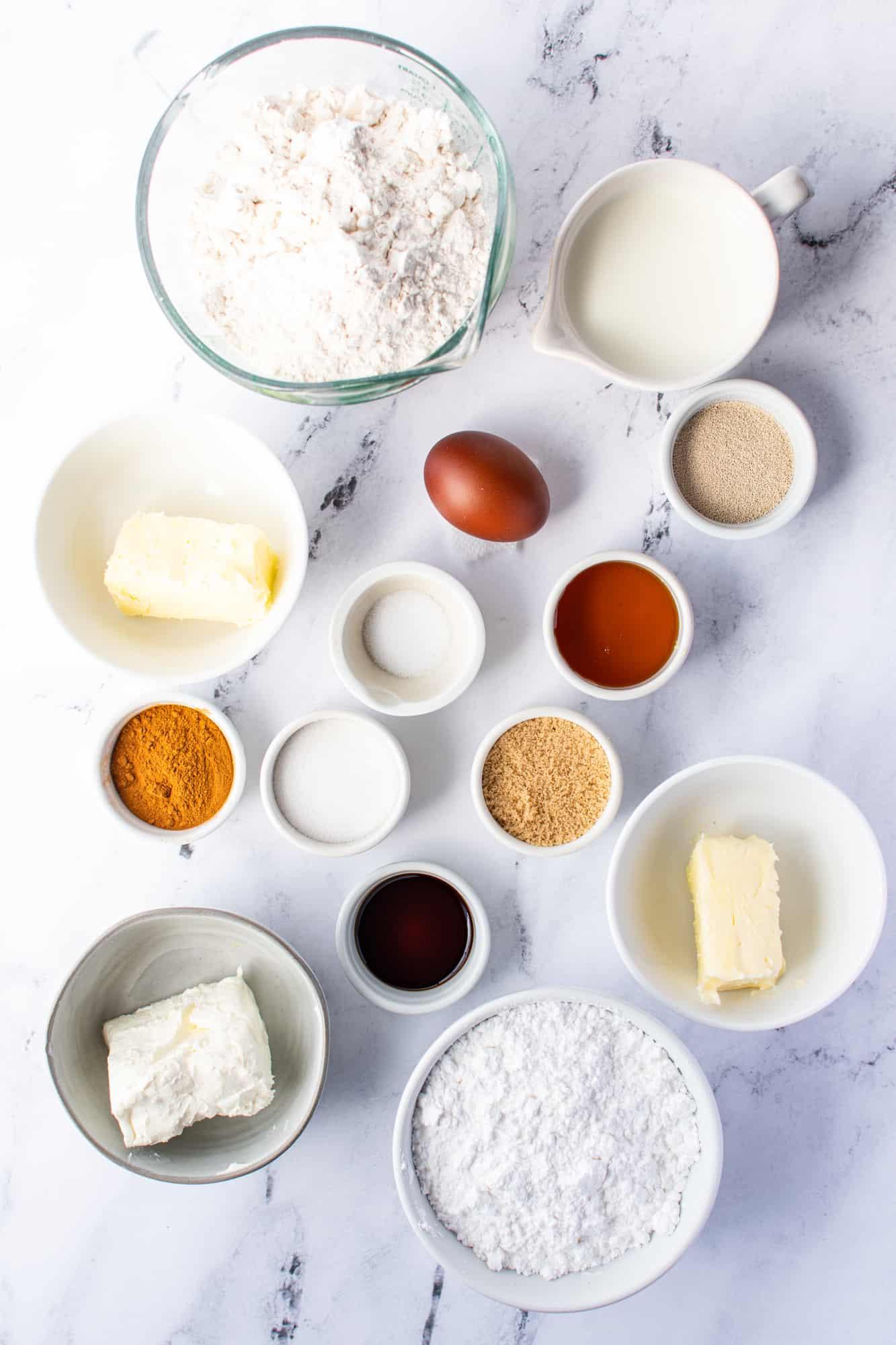 ingredients needed: milk, unsalted butter, instant dry yeast, honey, all-purpose flour, egg, salt, brown sugar white sugar, ground cinnamon, powdered sugar, cream cheese