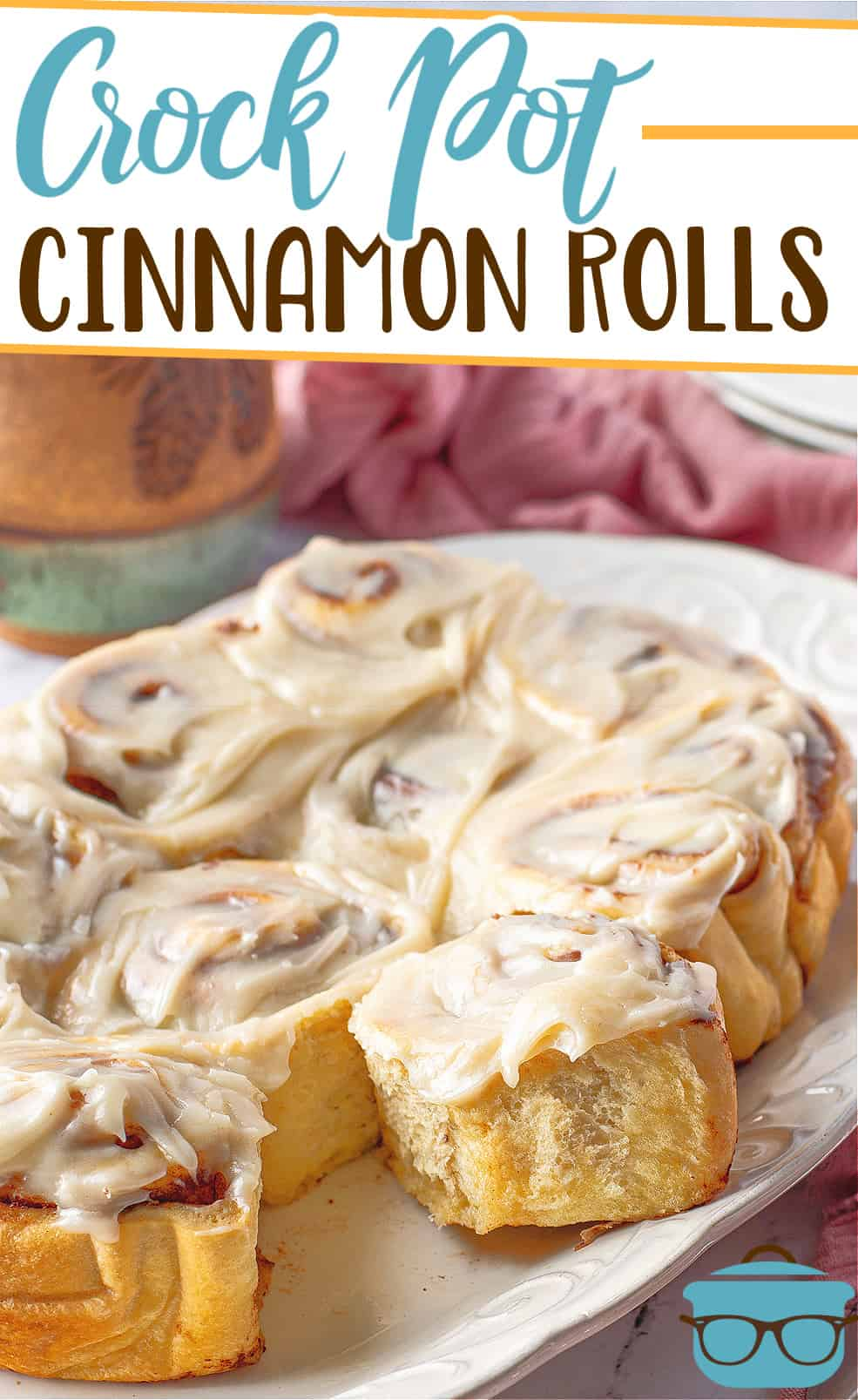 Homemade Crock Pot Cinnamon Rolls with Maple Cream Cheese Icing recipe from the Country Cook, shown on a large oval, white platter with a cup of coffee in the background