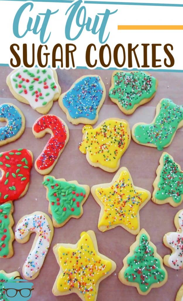 Cut-Out Sugar Cookies recipe from The Country Cook - colorful decorated sugar cookies shown on a large sheet of wax paper