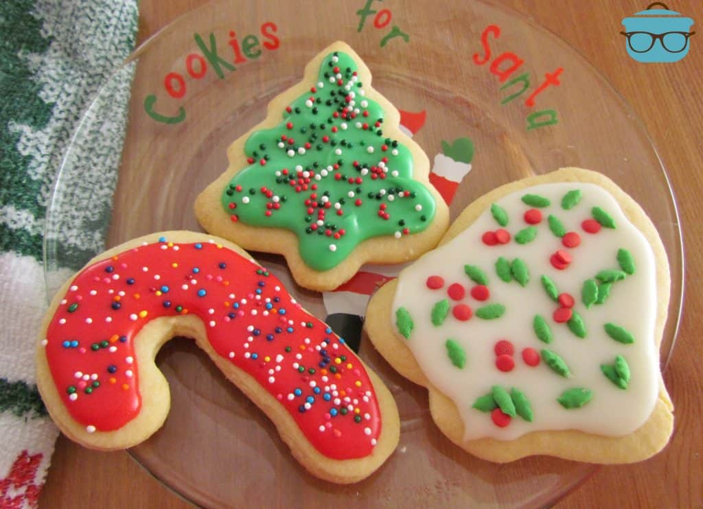 Cut Out Christmas Decorated Sugar Cookies on a clear 'Cookies for Santa' Plate