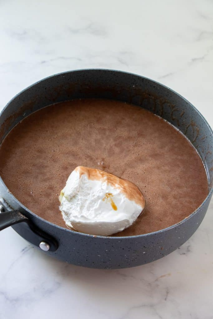 marshmallow fluff added to simmering hot chelate mixture in a large pan