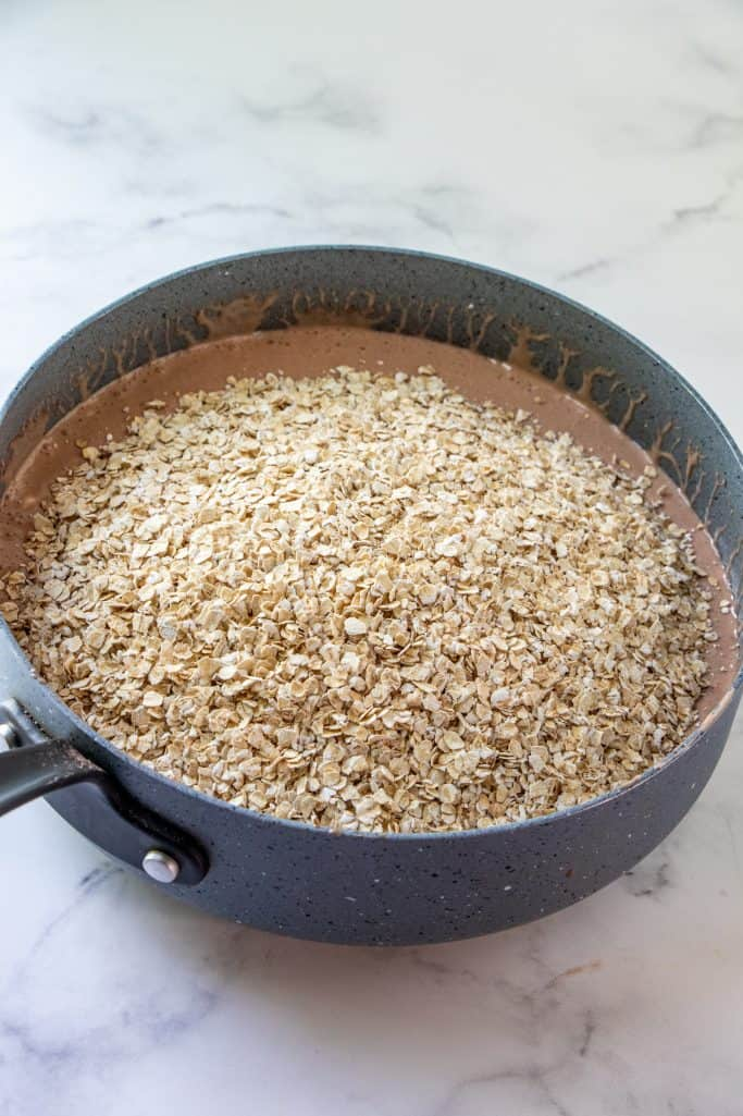 quick cooking oatmeal added to the chocolate fluff mixture in a large sauce pan