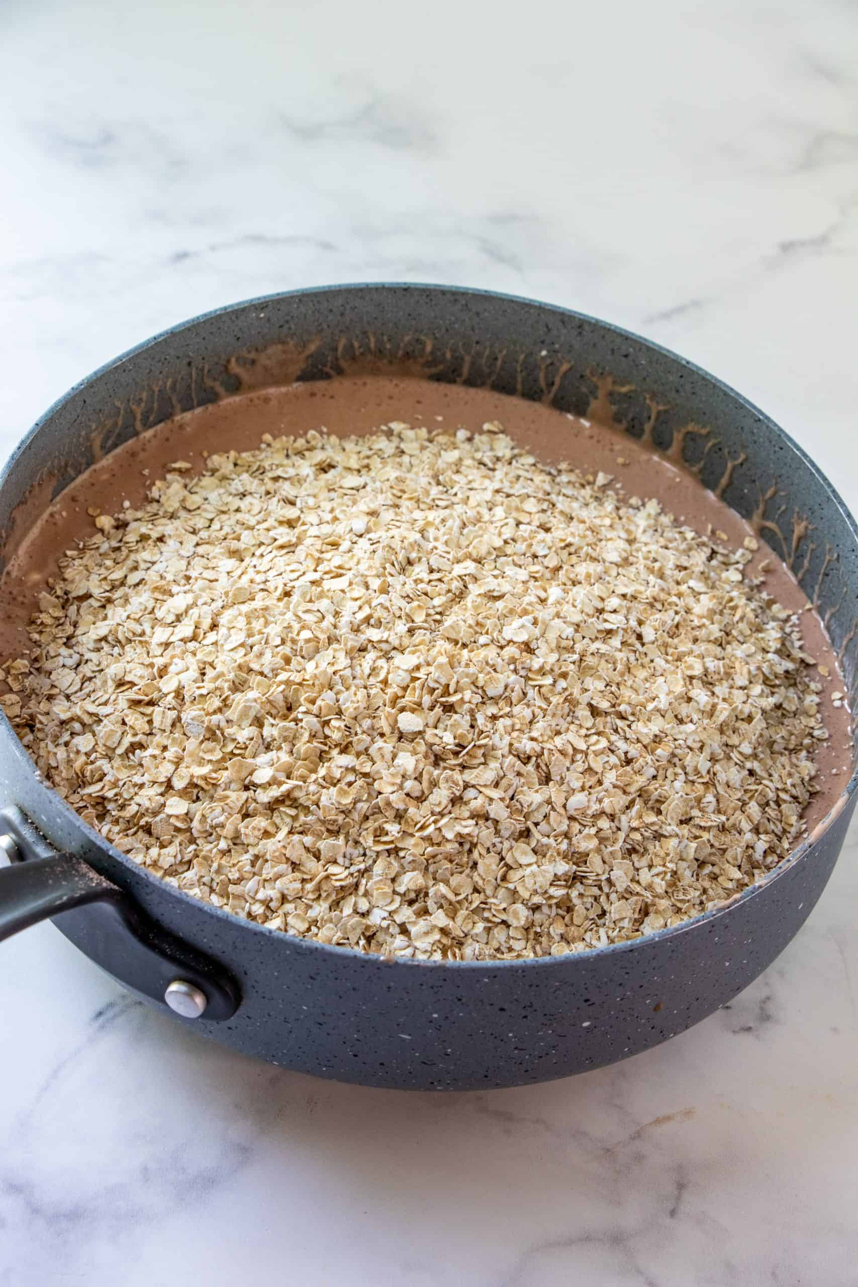 quick cooking oatmeal added to the chocolate fluff mixture in a large sauce pan.
