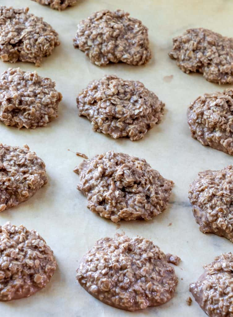 chocolate no bake cookies scooped onto parchment paper to cool