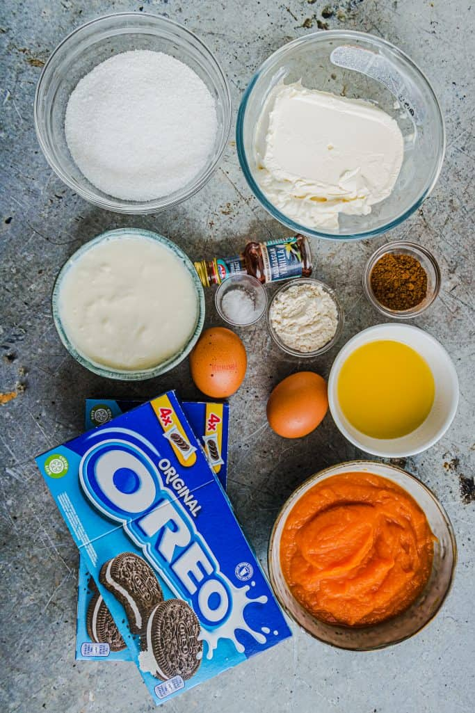 Oreo cookies, melted butter, cream cheese, granulated sugar, pumpkin pie spice, all-purpose flour, salt, eggs, pure pumpkin, sour cream, vanilla extract