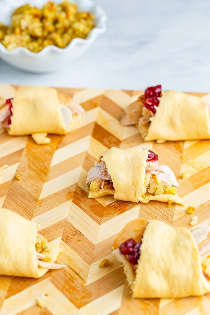 crescent roll bundles filled with sliced leftover turkey, turkey stuffing and whole cranberry sauce