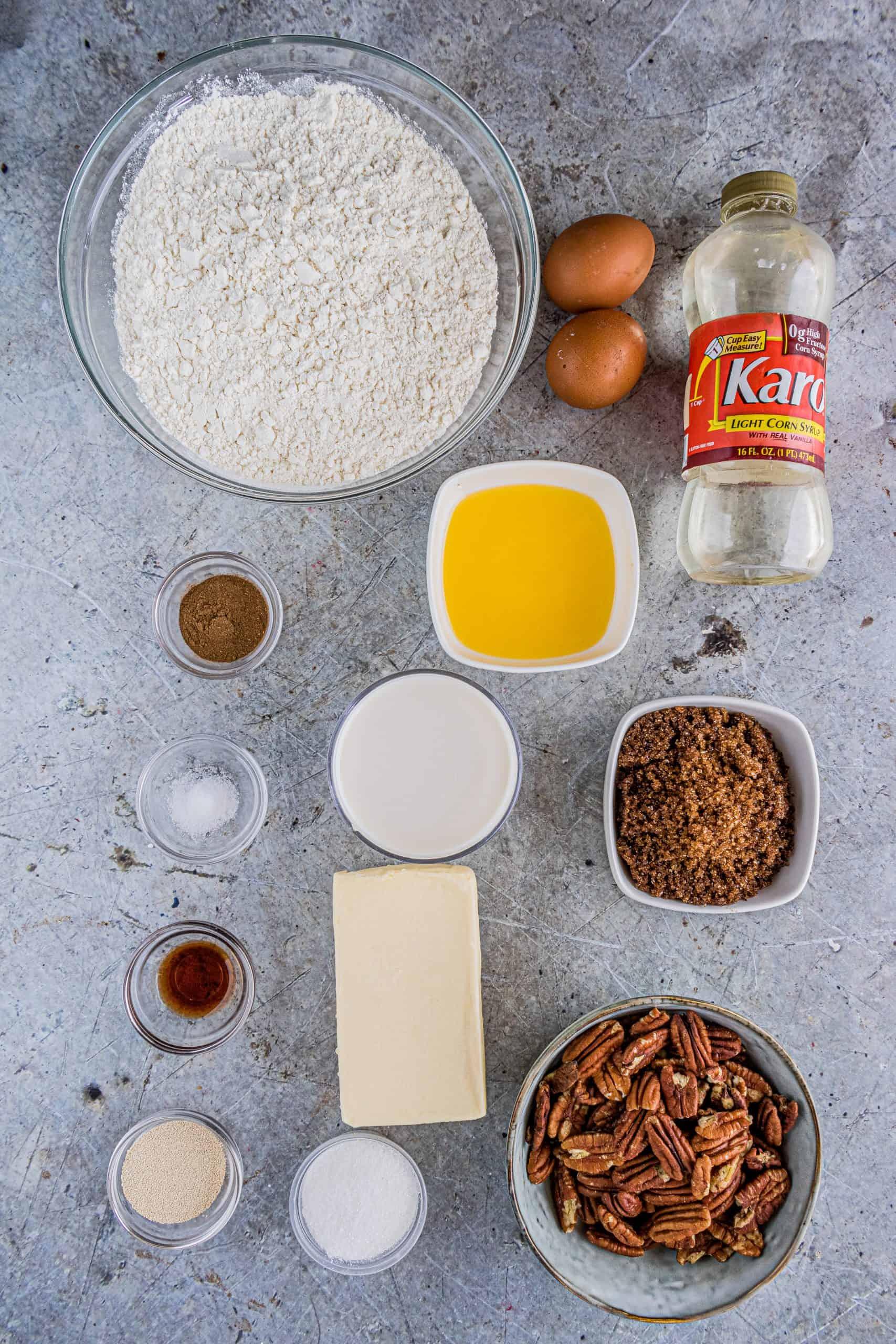 milk, instant active dry yeast, granulated sugar, all-purpose flour, light corn syrup, egg, vanilla extract, pecans, butter, dark brown sugar, cinnamon