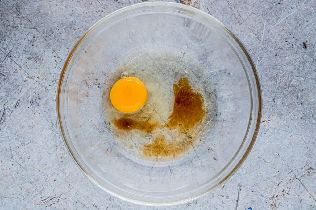 egg, corn syrup and vanilla extract in a clear glass bowl