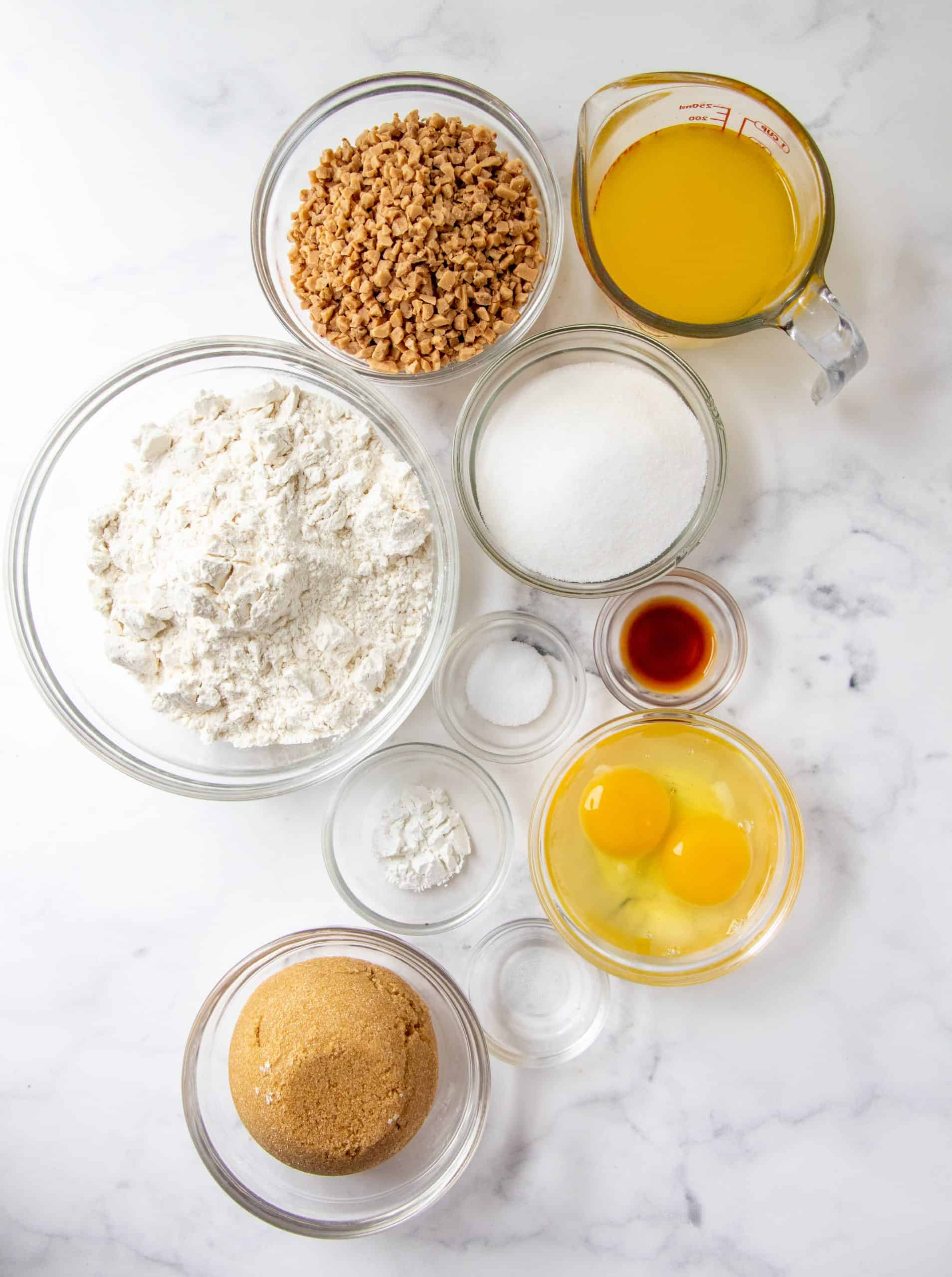 all-purpose flour, baking powder, salt, unsalted, light brown sugar, sugar, large eggs, vanilla extract, rum extract, toffee bits.