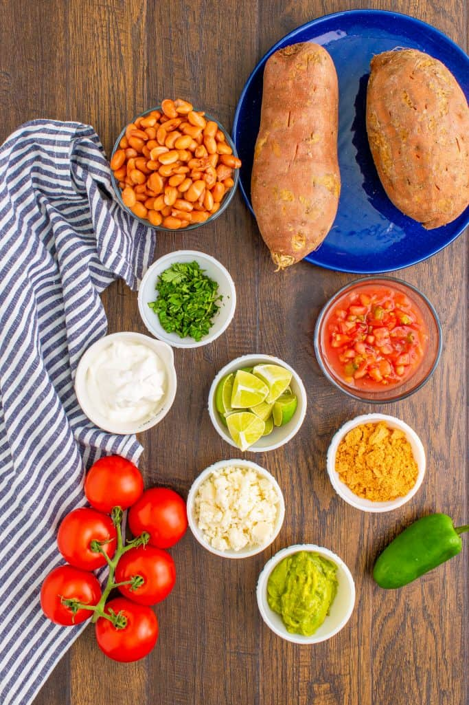 sweet potatoes, pinto beans, taco seasoning, salsa, fresh cilantro, sour cream, guacamole, queso fresco, tomatoes, jalapeno, fresh lime
