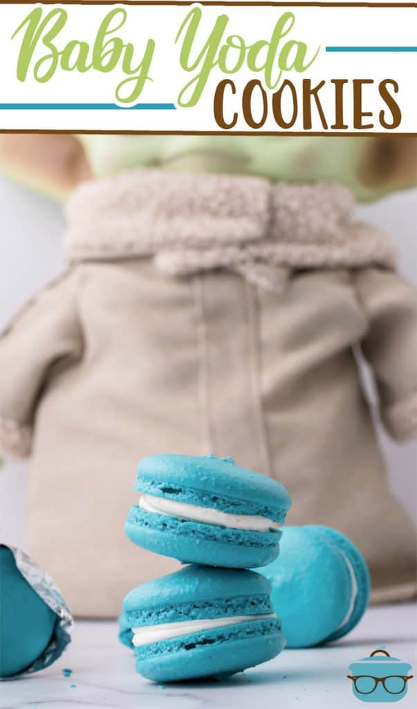 Baby Yoda Cookie recipe (Space Macarons) from The Country Cook, Baby Yoda doll standing up behind teal blue macarons that are stacked two high