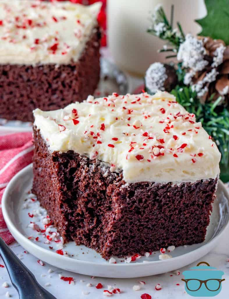 Chocolate Cake with Peppermint Frosting, slice shown on a small round white plate with a bite removed