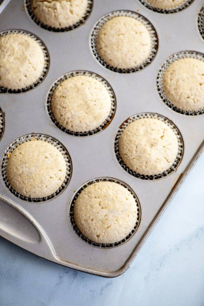 fully baked champagne cupcakes pictured in a cupcake pan