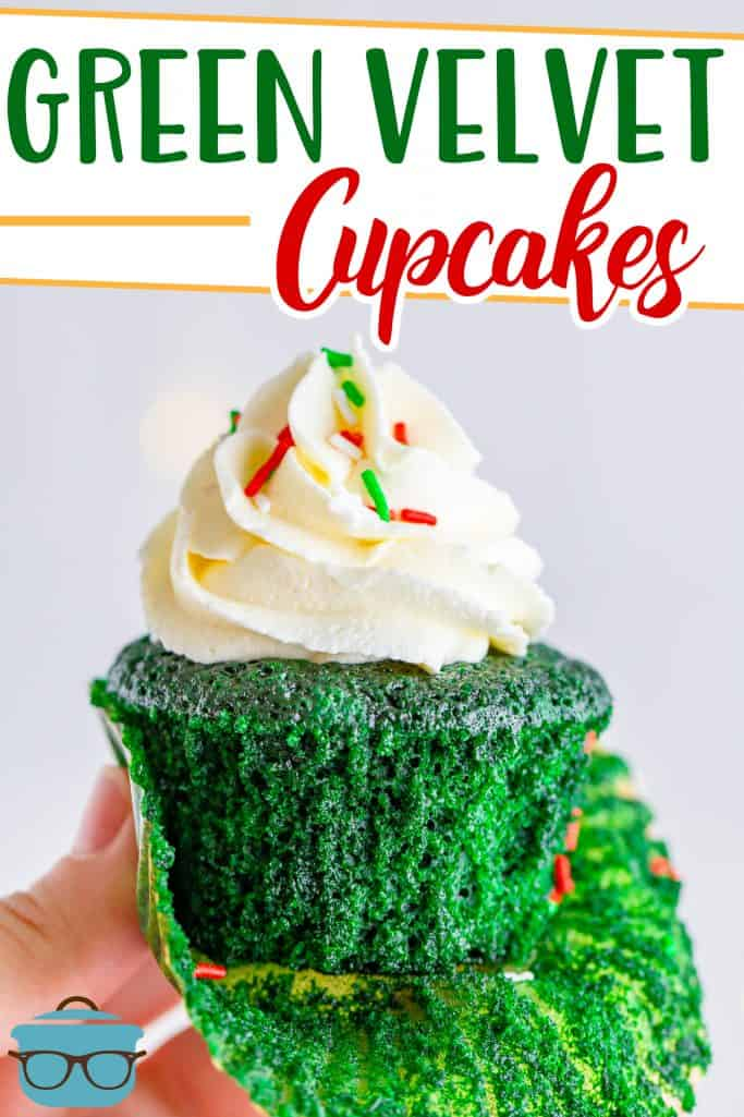 Green Velvet Cupcake recipe from The Country Cook, one cupcake being handheld with part of the cupcake liner removed to reveal the bottom of the cupcake
