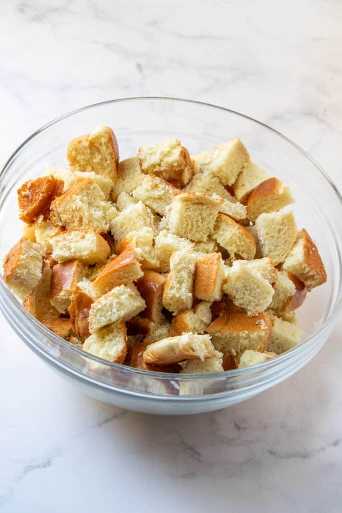 brioche bread cut into chunks and in a clear bowl