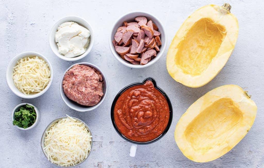 spaghetti squash, kielbasa sausage, ground Italian sausage, ricotta cheese, marinara sauce, Parmesan cheese, Mozzarella cheese, chopped parsley