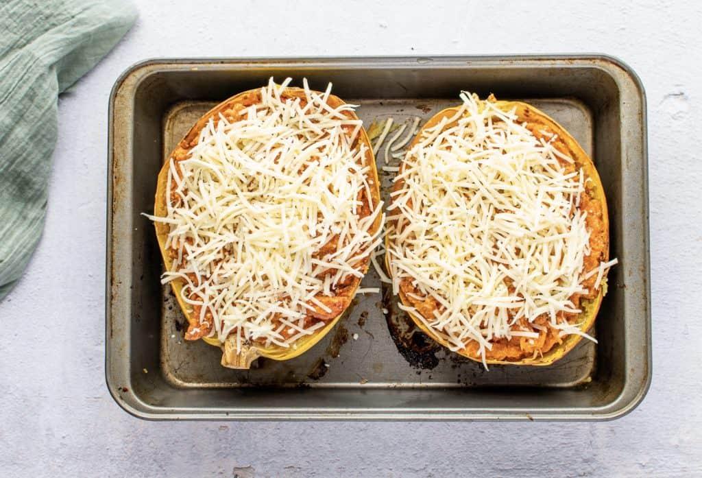 shredded mozzarella cheese on top of stuffed spaghetti squash