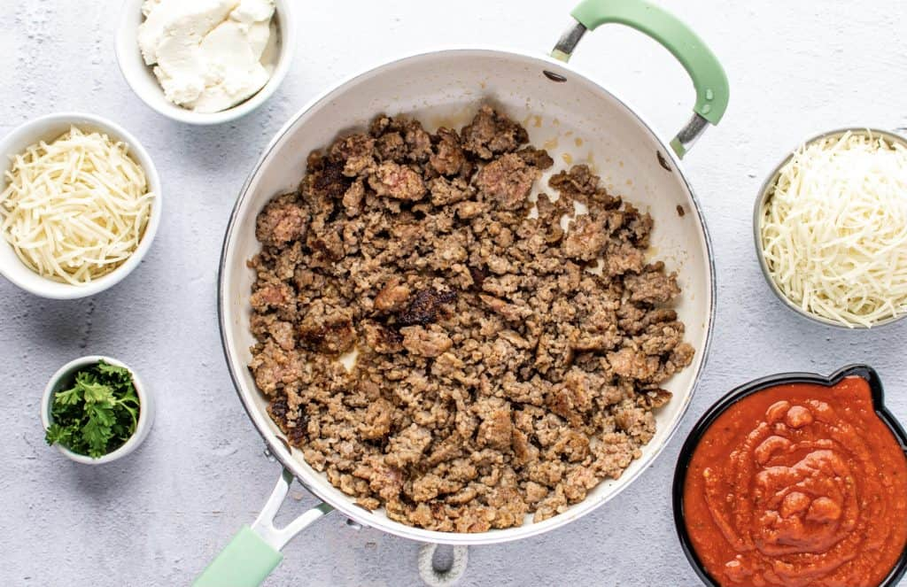 browning and crumbling ground Italian sausage in a skillet