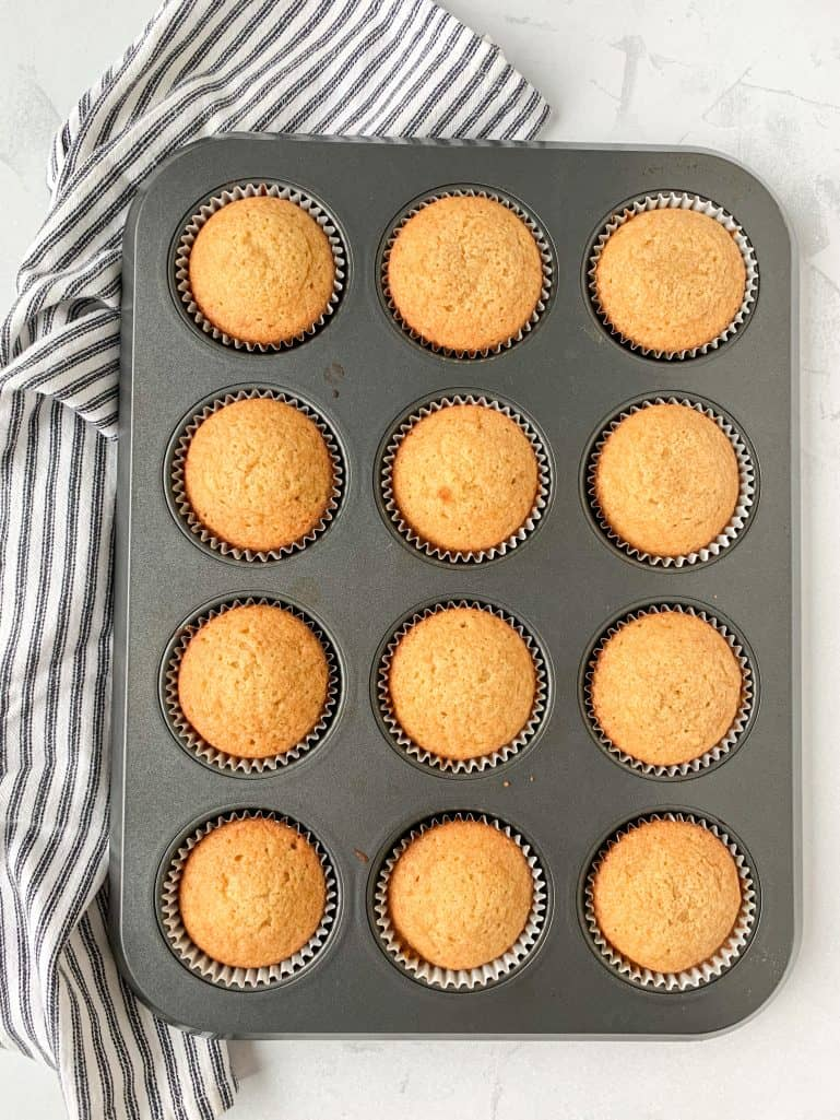 fully baked pecan cupcakes in a muffin tin