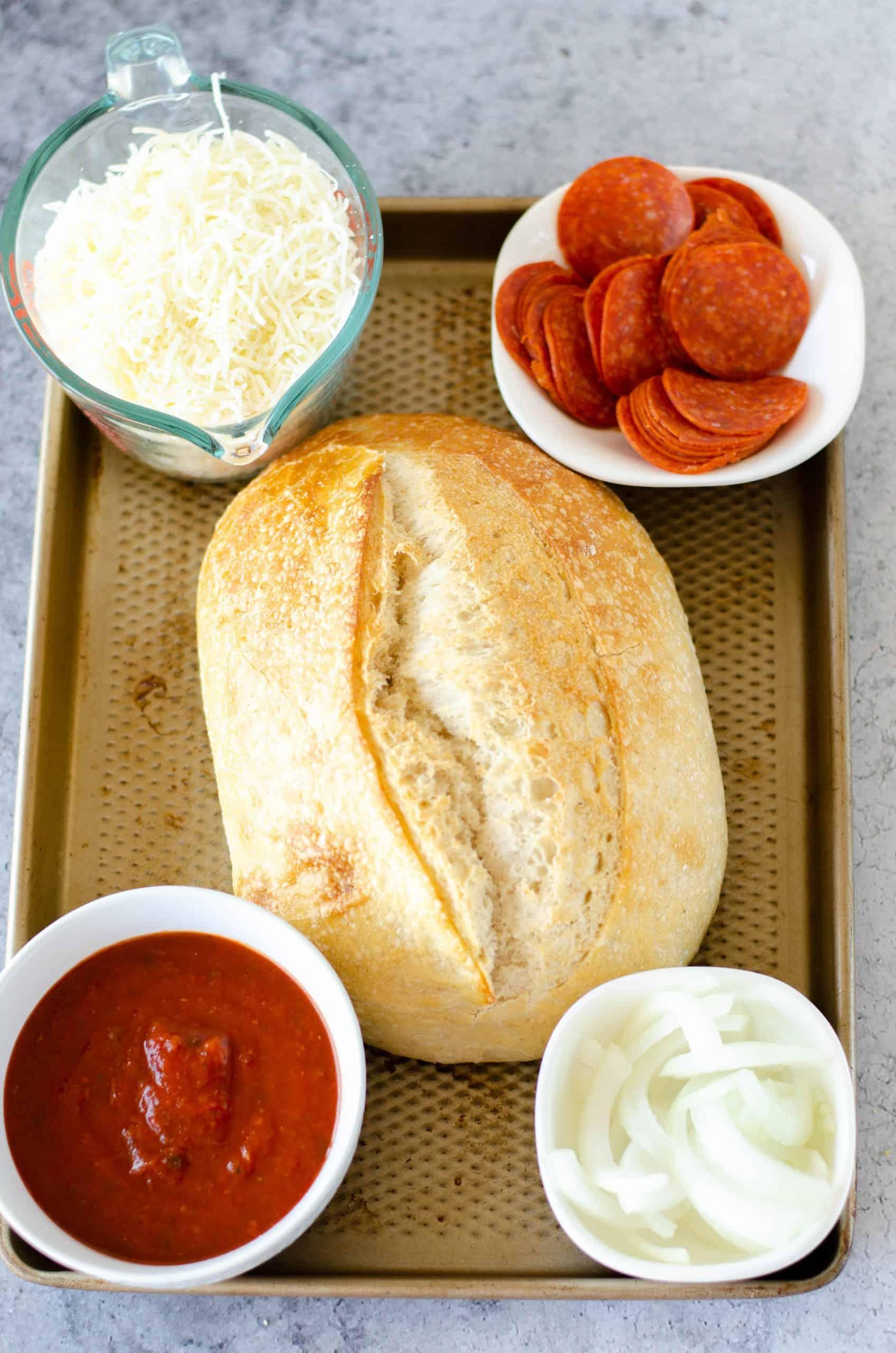 sourdough bread, pizza sauce, sliced pepperoni, sliced onion, shredded mozzarella cheese.