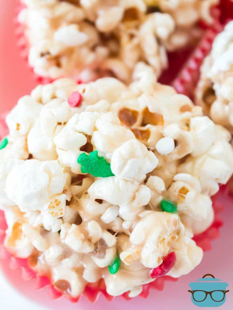 clopseup photo of finished popcorn ball in a red cupcake liner